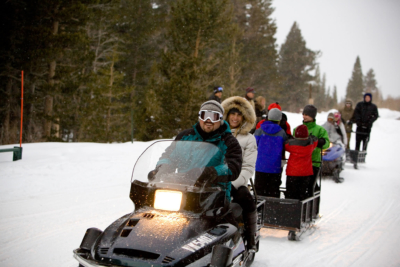 arriving to Rock Creek Lodge by snowmobile